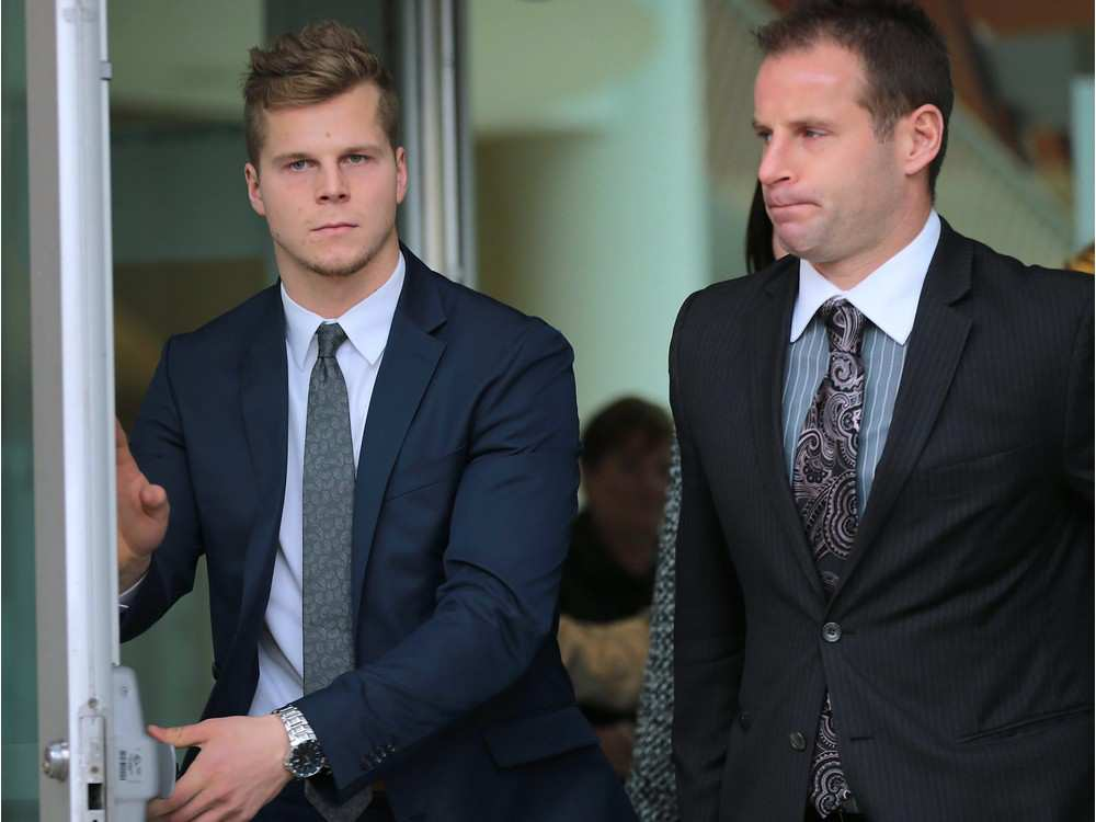 Ben Johnson (L) and his lawyer Evan Weber leave the Ontario Court on Thursday, November 12, 2015, after Johnson was found not guilty in a sexual assault case. Dan Janisse / Windsor Star